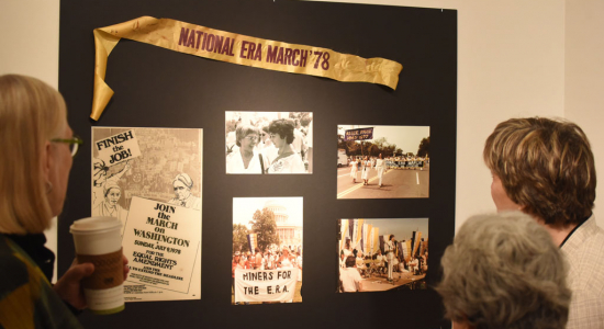 Viewing ERA March display at Chatham Feminist Alumni Opening Reception